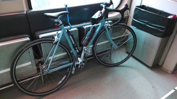 My bike taking up two seats on the Metra.  Two grumpy people probably had to move so I could park my bike.